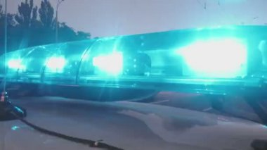 Emergency vehicle blue lights flashing, closeup. Police interceptor, ambulance — Stock Video