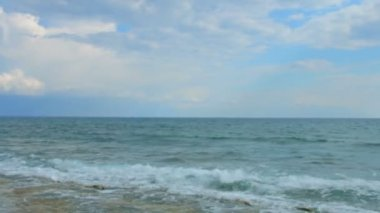 Lonely woman on beach, white scarf wrapped around her body. Marine landscape — Stock Video