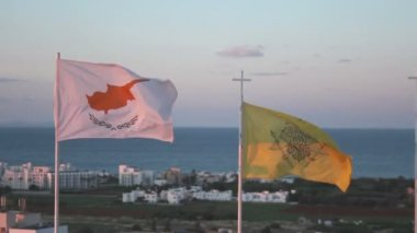 Flags of Cyprus and Greek Orthodox Church waving in wind, seascape on background — Stock Video