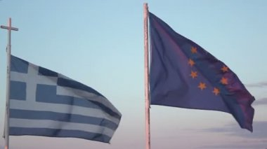 Flags of Greece and EU waving in wind against blue sky background, debt crisis — Stock Video