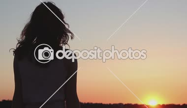 Young woman looking at amazing orange sunset on horizon, thinking about future — Stock Video