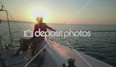 Two women sailing yacht, enjoying sea voyage, beautiful sunset, active rest — Stock Video