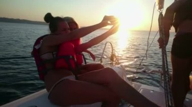 Hot chicks taking selfie on phone camera, having fun at yacht party, luxury rest — Stock Video