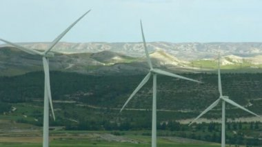 Alternative energy generation, nature conservation. Wind turbines, green hills — Stock Video