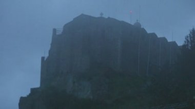 Time lapse of mist covering old stone church on mountain, mysterious atmosphere — Stock Video