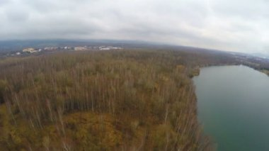 Aerial shot, forest with naked trees in autumn, spring, hunting, fishing season — Stock Video