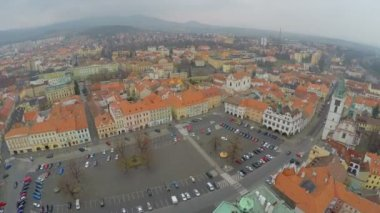 Aerial view of old city, central square, red roofs, gloomy mountains on horizon — Stock Video