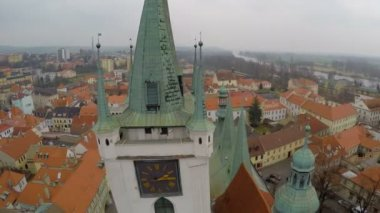 Aerial shot of main clock on old city hall tower, beautiful city with red roofs — Stock Video
