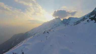 Majestic mountain range, snow groomer cleaning skiing run, extreme sport, resort — Stock Video