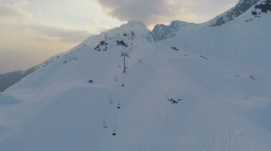 Snowy Alps, popular resort for extreme sports, snowgroomer cleaning ski way — Stock Video