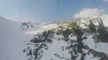Real time view from cablecar cabin moving over snowy mountains, extreme sport — Stock Video