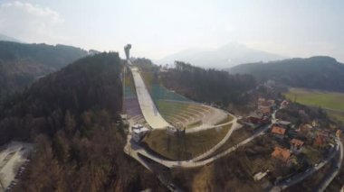 Aerial view of Austrian Bergisel ski jump training center, Olympics, off-season — Stock Video