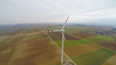Wind turbines rotating on green field. Alternative source of energy. Aerial view — Stock Video