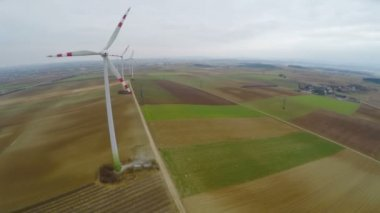 Aerial view of wind turbines with huge rotating blades. Green energy production — Stock Video