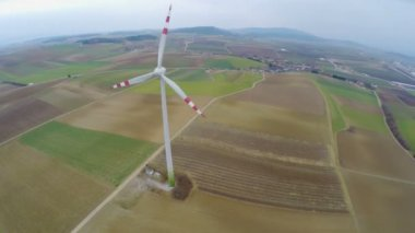 Huge spinning blades of wind turbine in countryside, aerial. Power generation — Stock Video