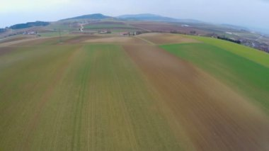 Aerial view of beautiful green landscape with cultivated fields and farmland — Stockvideo