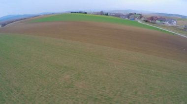 Flying across cultivated fields in countryside. Agricultural industry, farmlands — Stock Video