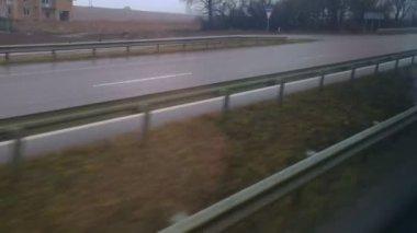 Passenger of car, bus looking through window, POV. Wet road on gloomy, rainy day — Stock Video
