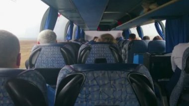 Tourist bus full of passengers. People traveling on a budget, in economy class — Stock Video