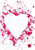 Red ink spots that form the shape of a heart. — Stock Photo