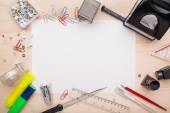 Office supplies and a white piece of paper in the center — Stock Photo