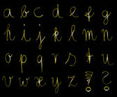 Flourescent lettere dell'alfabeto in colore giallo luminoso al neon — Foto Stock