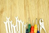 Wrench and small colorful screwdriver — Stok fotoğraf