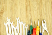 Wrench and small colorful screwdriver — Stock Photo