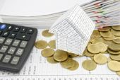 House on pile gold coins with calculator — Stock Photo