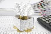 Pile gold coins in house overload and calculator — Foto Stock