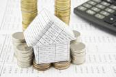 House on pile gold and silver coins with calculator — Foto Stock