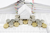 House on pile silver and gold coins — Stock Photo