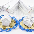 House and gift box on pile of gold coins — Stock Photo #61170311