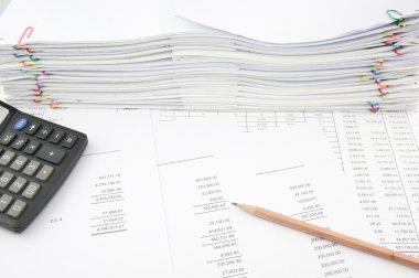 Balance sheet with pencil and calculator