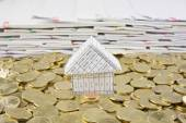 House in heap of gold coins — Stock Photo