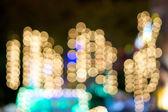 Defocused of gold glitter or bokeh circle at night — Stock Photo