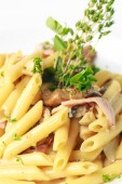 Penne with ham — Stock Photo