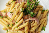 Penne with ham — Foto Stock