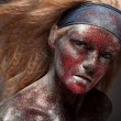 Female demon with face art — Stock Photo #61639807