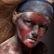Female demon with face art — Stock Photo #61639901