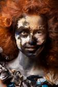 Red haired woman with face art — Stock Photo