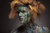 Woman with traditional african tribal face paint — Stock Photo