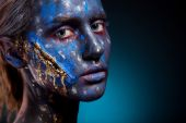 Blue face art woman with scar on face — Stock Photo