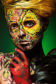 Woman with body and face art — Stock Photo