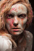 Woman covered in healing clay — Stockfoto