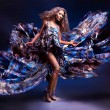 Woman dancing with flying dress — Stock Photo #62172279