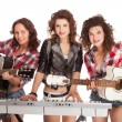 Female trio band performing music — Stock Photo #68949553