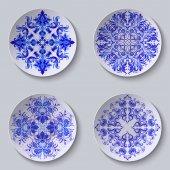 Set of floral circular plates — Stock Vector