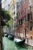Gondolas moored along a canal in Venice — Foto Stock