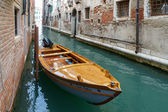 Motorboat moored in a canal in Venice — Stock Photo